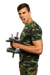 Military young man exercises with dumbbell