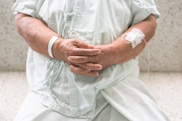 Closeup senior patient's hands