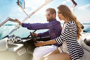 Sexy couple on the luxury yacht