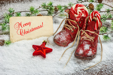 Christmas decoration red stars, sweets and antique baby shoes