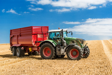 Tractor with Trailer on the field during harvest time - 2920