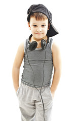 Little deejay. funny smiling boy with headphones on white