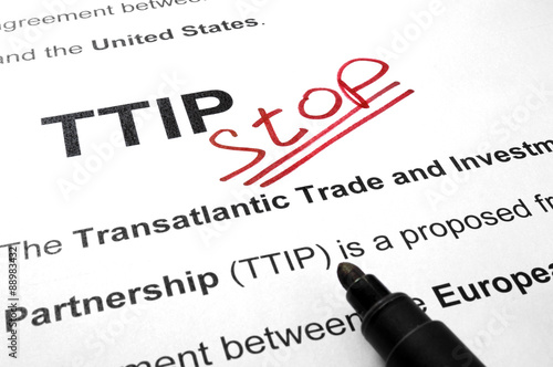 Words TTIP stop on a paper and marker.