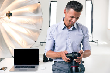 Happy businessman using camera