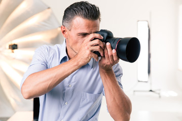Photographer making photo on camera