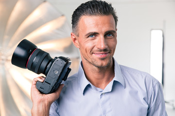 Happy photographer holding camera
