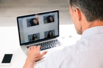Photographer using laptop