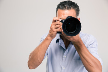 Portrait of a young photographer with camera