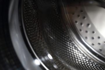 closeup image of washing machine, abstract metallic texture