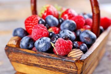 Sweet tasty berries in basket close up