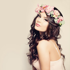 Beautiful Woman with Curly Hair, Makeup and Flowers Wreath