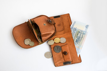 Two leather wallets with coins.