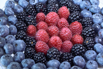 some sort of berries: blueberries, blackberries, raspberries