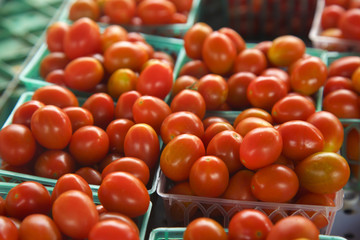 Grape tomatoes in basket at market