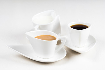 three coffee cups on white stone table 3