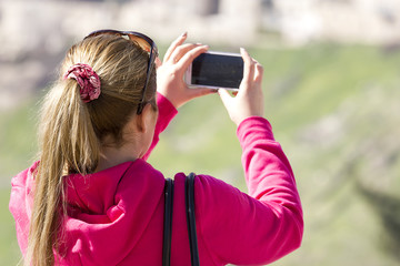 Woman taking photograph with smartphone at enjoying view of Jerusalem