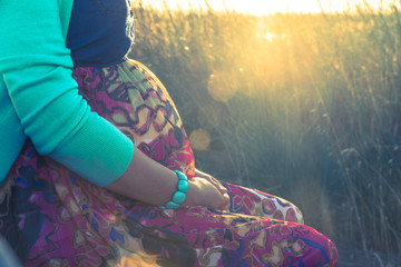 Outdoor shot of young pregnant woman in colorful dress