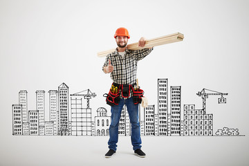 builder in uniform showing thumbs up
