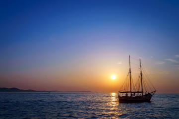 Sailing boat on the Mediterranean sea at the sunset