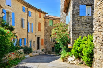 Fototapete - Pretty houses with colorful shuttered windows in a quaint village in Provence, France