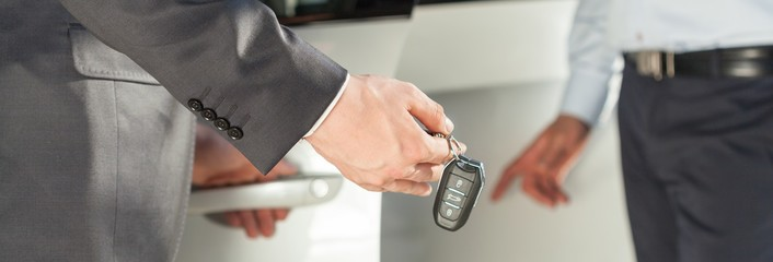 Man with car keys in hand