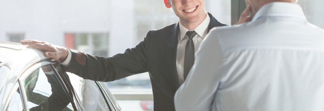 Smiling man by the car