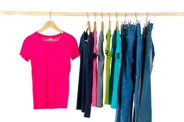 different colorful shirt and jeanson wooden hangers