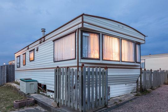 Mobile home on a trailer park at dusk