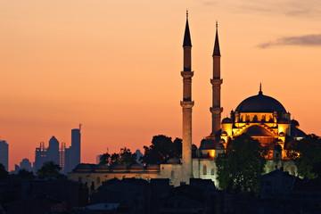 Blue Mosque (Hagia Sophia) at Sunrise against Modern Architecture