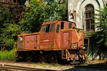 Old rusty Russian train in the territory of thrown factory, established near Green Island in Rostov - on - Don.