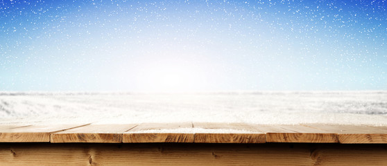 wooden desk and snow