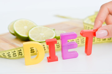 Measurement of diet results concept with fruits on wooden cutting board