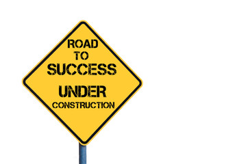 Yellow roadsign with Road To Success Under Construction message