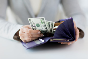 close up of woman hands with wallet and money