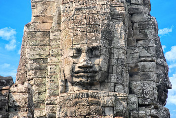 Ancient stone faces of Bayon temple in Angkor Thom, Siem Reap, Cambodia
