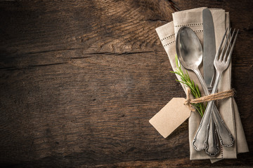 Vintage silverware with an empty tag
