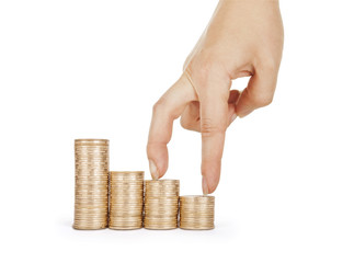 Economics growth concept - profit goes up. Hand and coins isolat