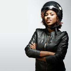 Young woman biker in black helmet