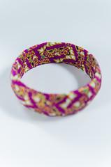 wrist bracelet of beads and precious stones Selective focus point