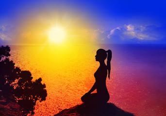 Yoga and meditation. Silhouette of woman.