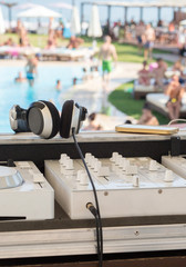 White Dj mixer on a swimming pool party