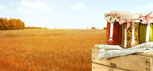 jars and autumn landscape