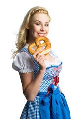 attraktive blonde Frau im Dirndl mit Brezel