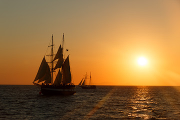 Sailing ship silhouette in sunset on the sea