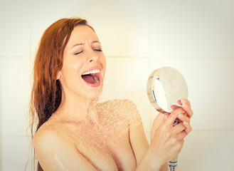 Young woman singing in the shower