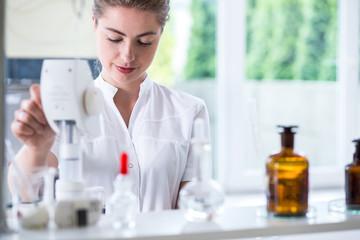 Lab technician doing chemistry experiment