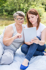 Mature female and modern technology