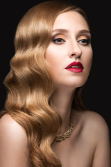 Beautiful woman with evening make-up, red lips and curls. Beauty