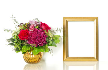 Bouquet of rose flowers and golden frame for your picture