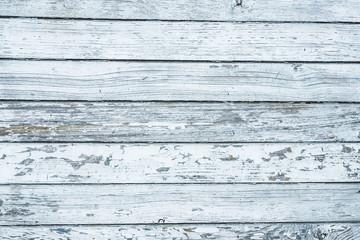 Grunge peeling paint white wood texture.